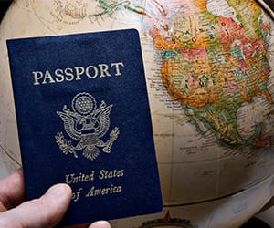 A United States passport held over a globe