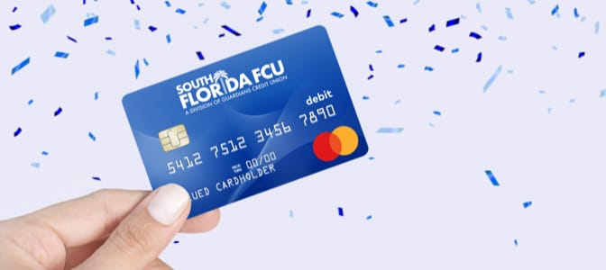 The SFFCU, A Division of Guardians CU Mastercard Debit Card surrounded by confetti.