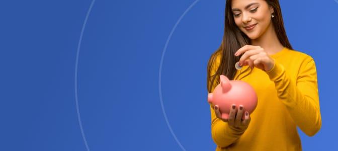 A teenager depositing a coin into a piggy bank.