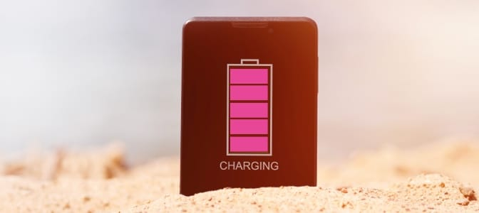 A woman laying on a beach chair.