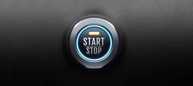 Backseat view of Santa Claus driving a convertible throw a snowy road.