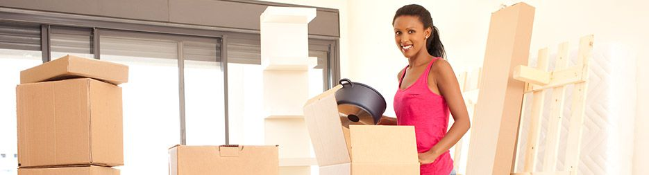 A young woman unboxing in a new home.