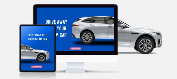 Interior view of a couple happily driving in a new car.